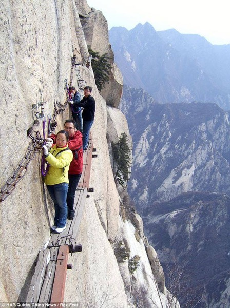 The tourist trek thousands of feet up a Chinese mountain along wooden boards that were nailed together 700 years ago